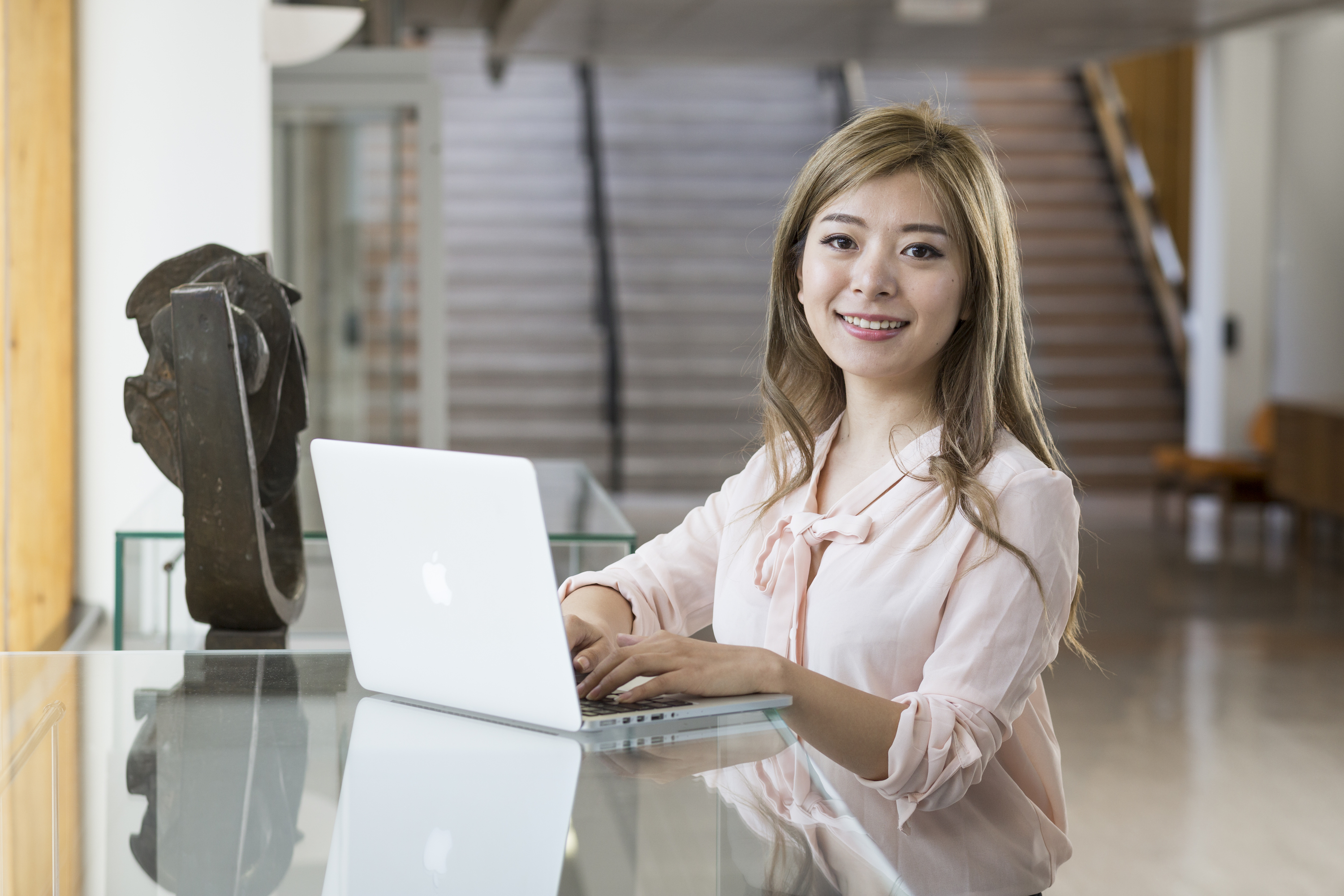 Anika Zhang - chinese girl in pink top with laptop