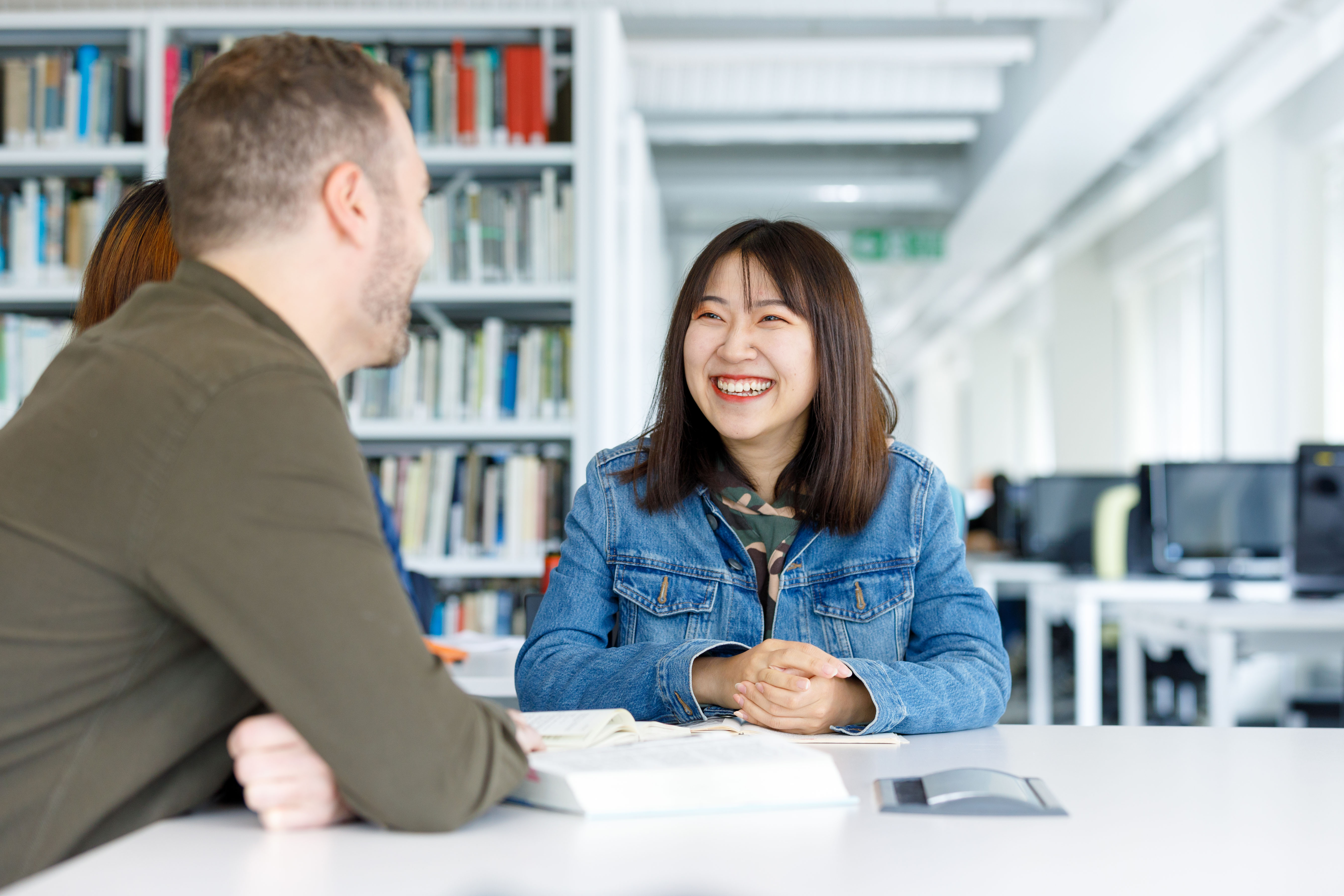 Chinese and European students discussing and studying in the library